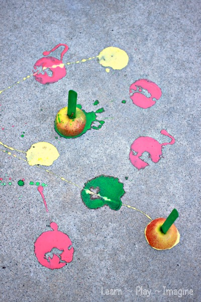 Apple printing with homemade scented sidewalk chalk paint.