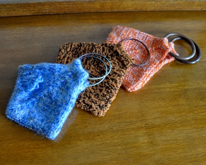 knitted triangular purses with bangle handles