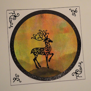 Sponged ink hills on brayered background with reindeer