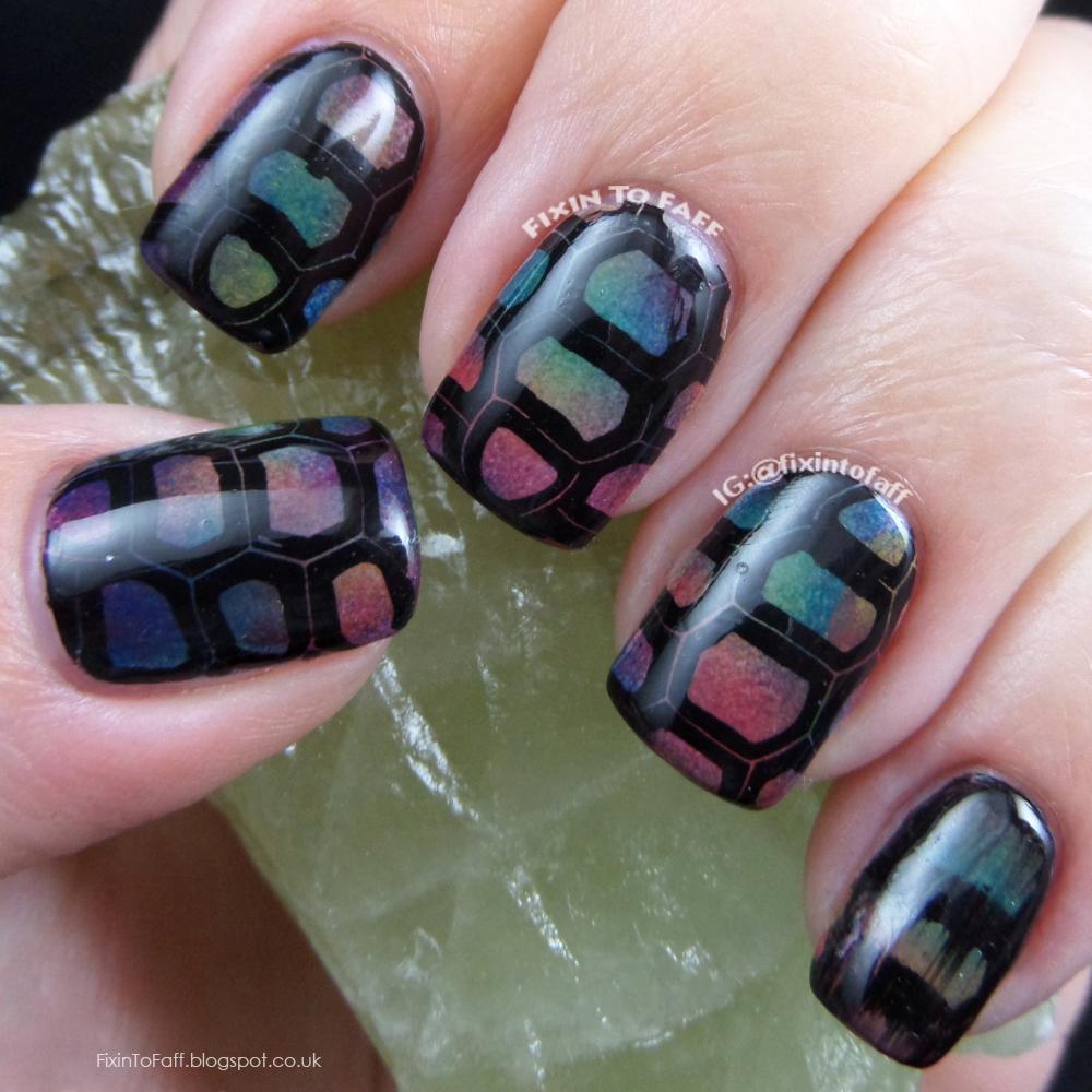 Rainbow tortoise print nail art.