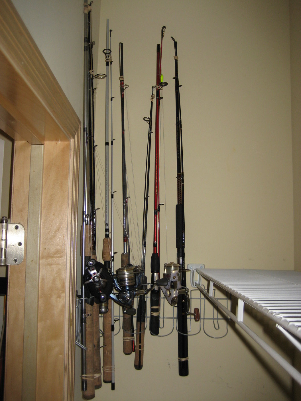 Fishing rod rack 10 ikea hack signum cable management for Fishing rod holders for home