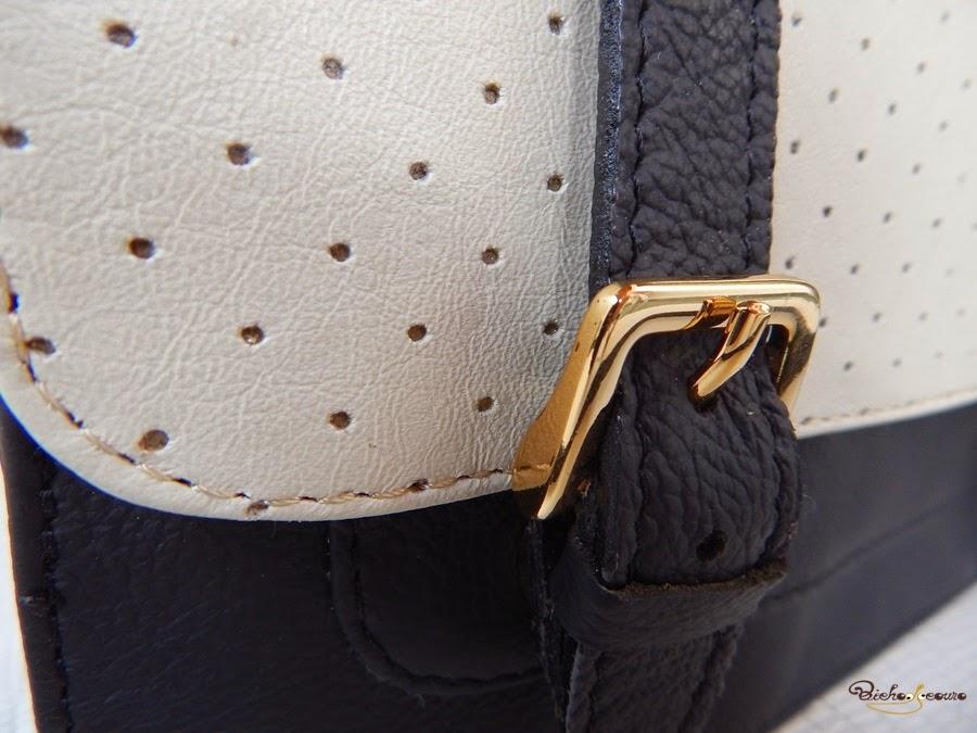 bolsa preta e branca