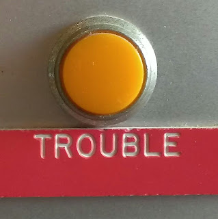 a yellow light labeled trouble
