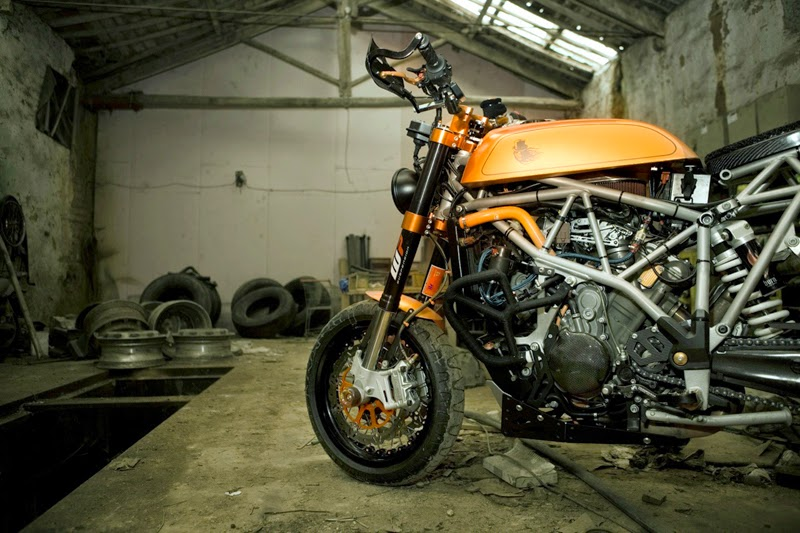 "Custom KTM | KTM Cafe Racer. KTM Modified into a beautiful Cafe racer. This Custom KTM Cafe Racer is based on 2006 KTM 950 SM. This KTM 950 ""Cafe racer"" gives a ""neo-retro"" appeal. Custom KTM is named Miss Hyde KTM by Osiyuyu. KTM Modifications Honda CB 750 gas tank, Custom  Kineo wheels, Pirelli Phantom tires, KTM racing Neken handlebars, EMIG racing triple trees, Custom carbon fiber seat cowl, Cafe racer seat, KTM Custom Exhaust."