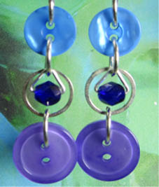Long Blue Earrings have small beads in silver rings highlighted between two fashion buttons