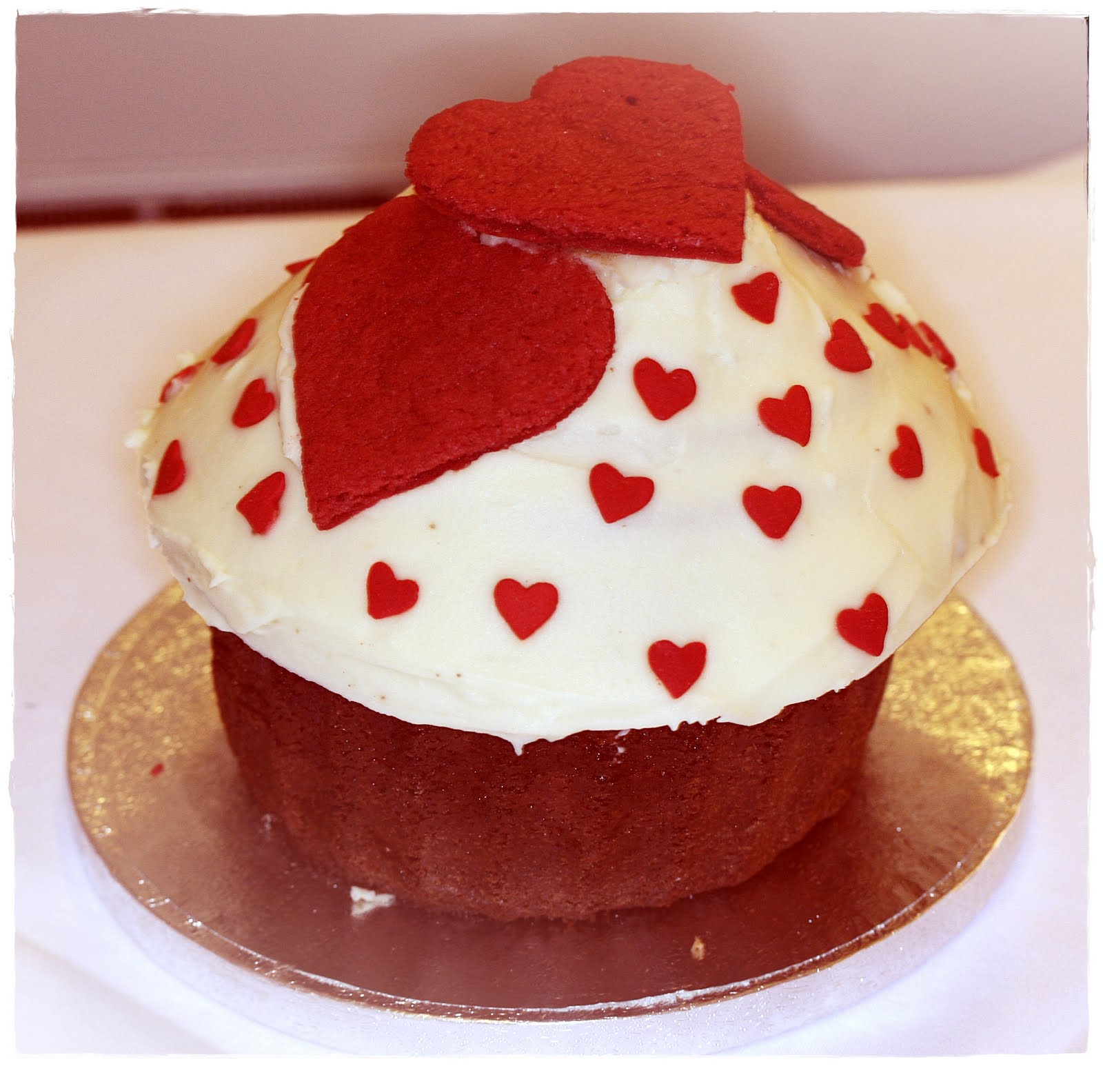 cupcake super duper giant vanilla cupcake topped with three red heart ...