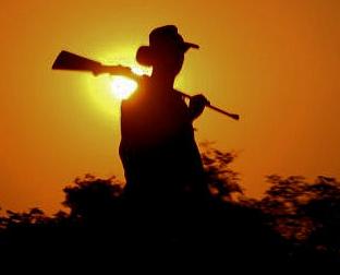 Man Sunset Rifle