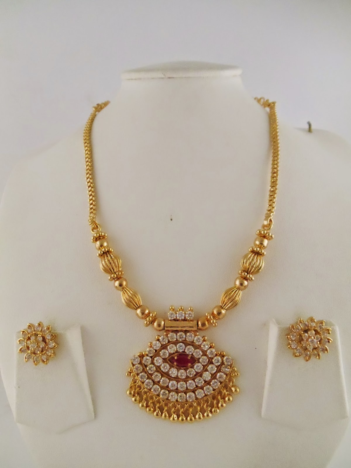 Jewellery Designs : Latest Simple Gold Pendent Set Haram design