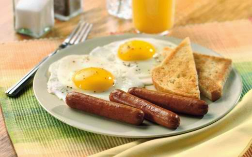 Simple breakfast - link sausage, fried eggs and wheat toast
