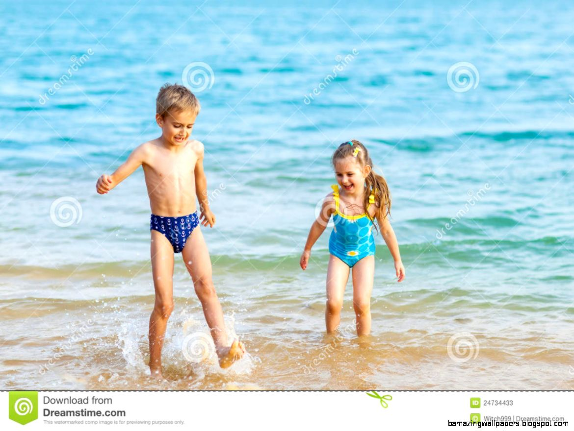 Happy Kids Playing At The Beach Shore Stock Photos   Image 24734433