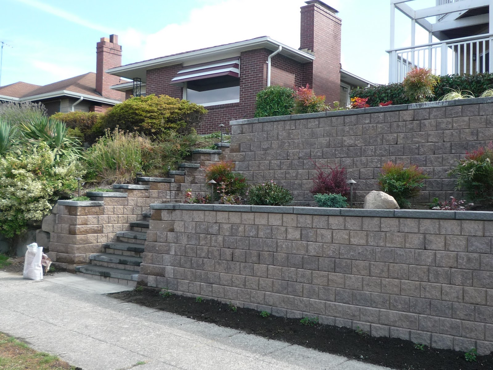 journeys far and wide  my front yard retaining wall