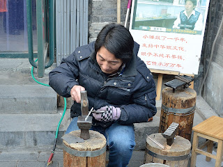 Silversmith on Nanluoguxiang in Beijing