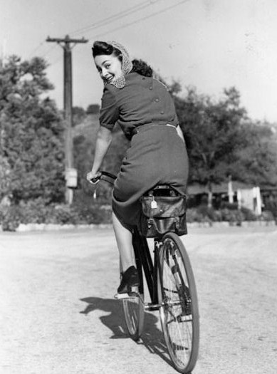 head scarf vintage lady on bike