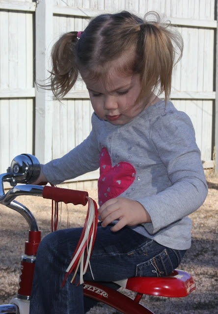 little girl on tricycle