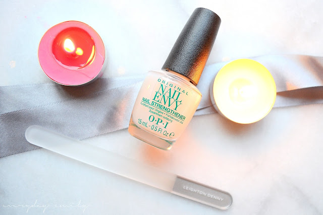A bottle of Opi nail envy and Leighton Denny's glass nail file