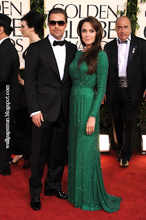 Actors Brad Pitt and Angelina Jolie arrive at the 68th Annual Golden Globe Awards