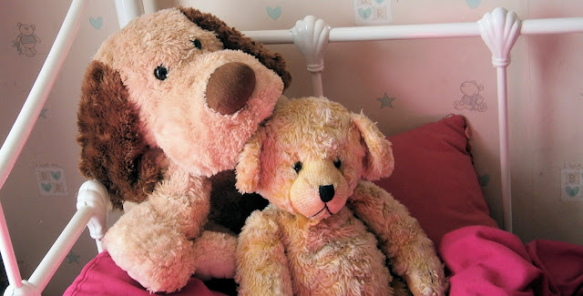 Teddy bear on girls bed
