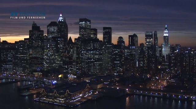 Photo of Lower Manhattan buildings at sunset