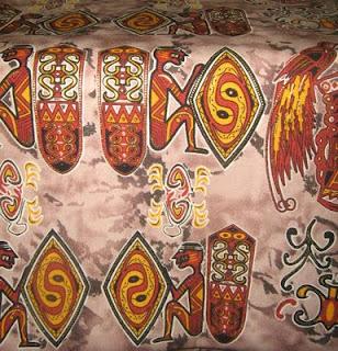 Batik Asmat dengan motif gambar patung duduk