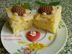 Citromos kocka és muffin recept, kevert tésztás, tejtermék mentes sütemény, citromos mázzal és színes cukorral a tetején.