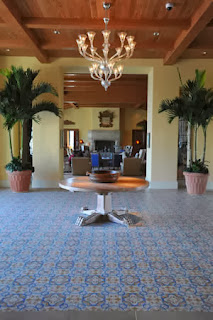 San Tropez cement tile pattern, used in this resort's lobby, features a color pallet that includes blue, mustard, white and gray.