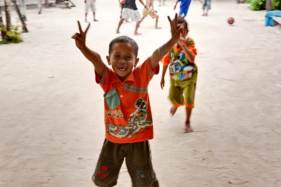 children playing football on tiny Derawan Island off the coast of Borneo