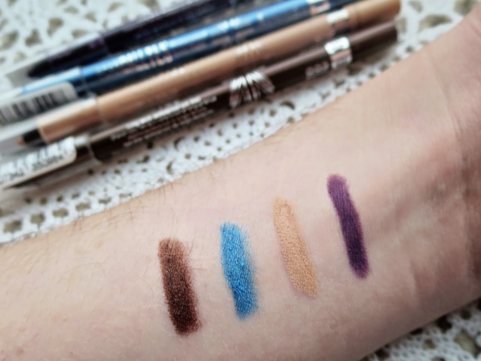 a picture of Rimmel Scandaleyes Kohl Kajal in brown, turquoise, nude, purple (swatch)