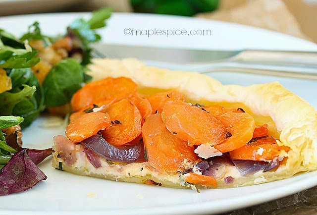 Vegan Carrot and Thyme Puff Pastry Tart with Almond Feta and Caramelized Red Onions.