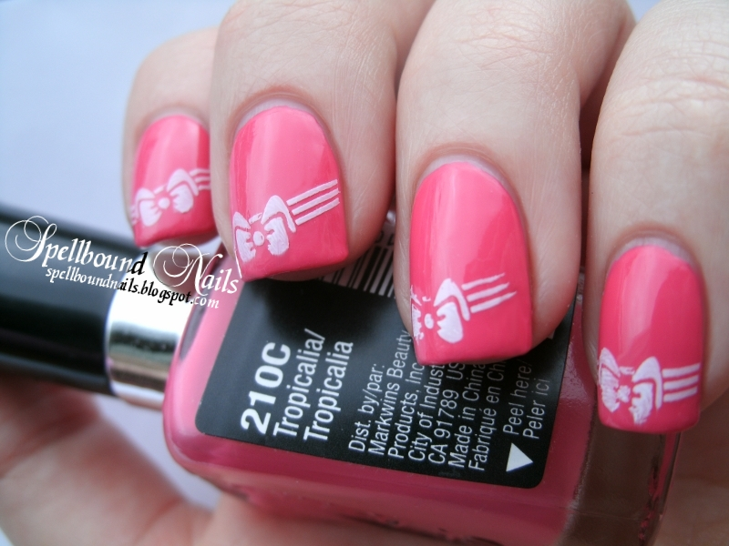 white Stamped Bows nail art on pink