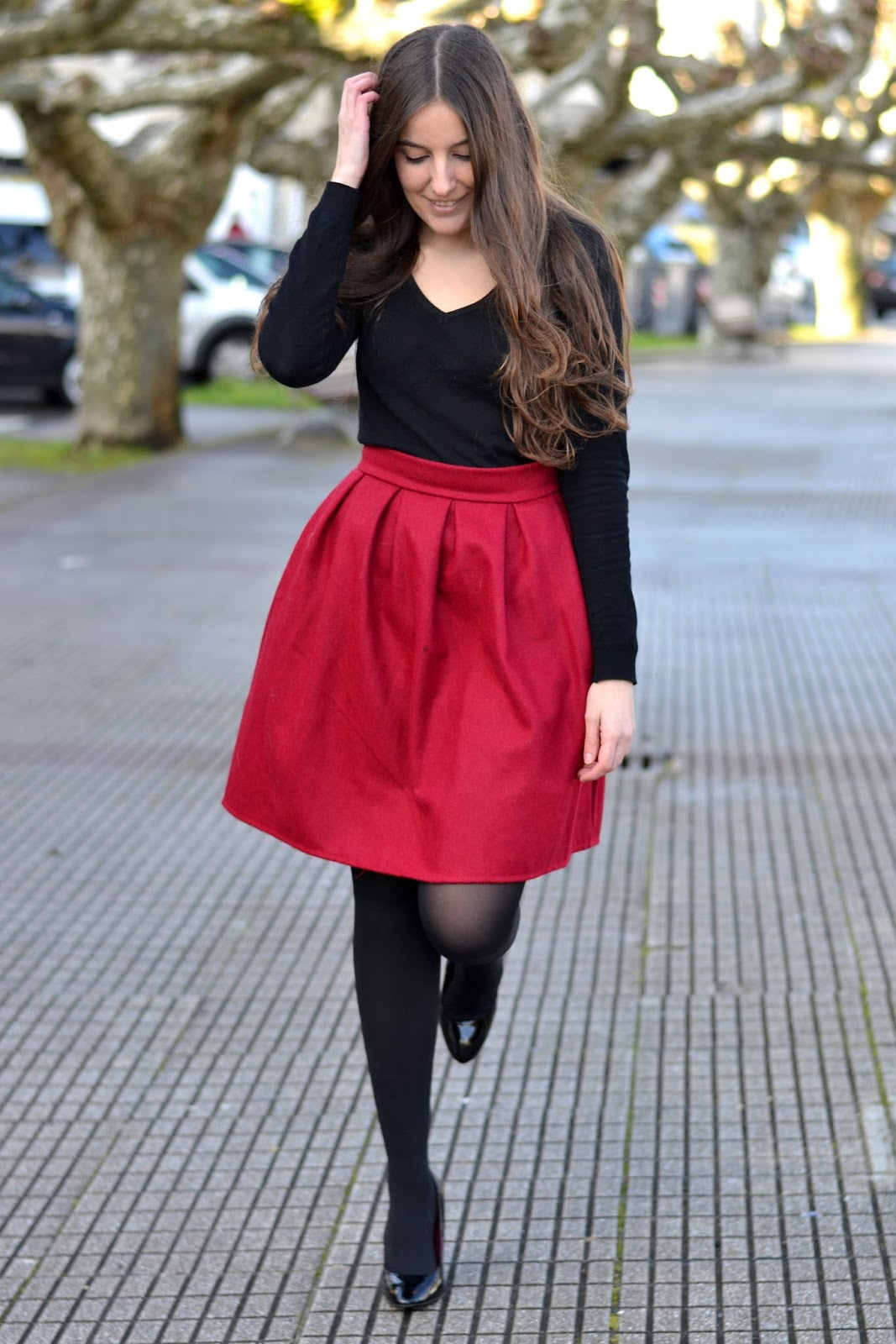 red midi skirt, black heels