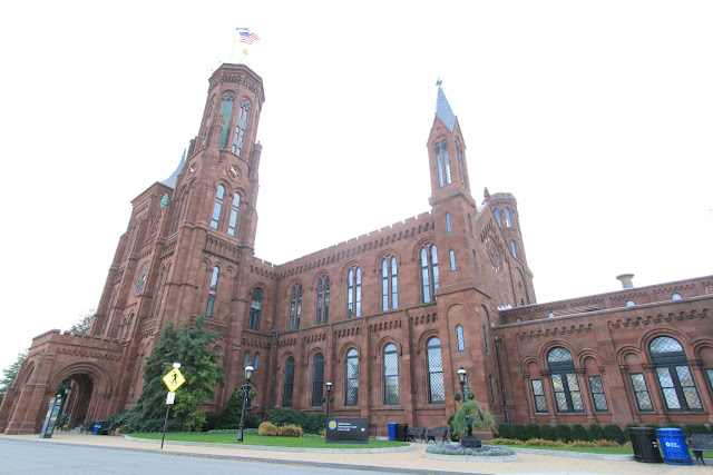 The side view of Smithsonian Castle located on the National Mall in Washington DC, USA