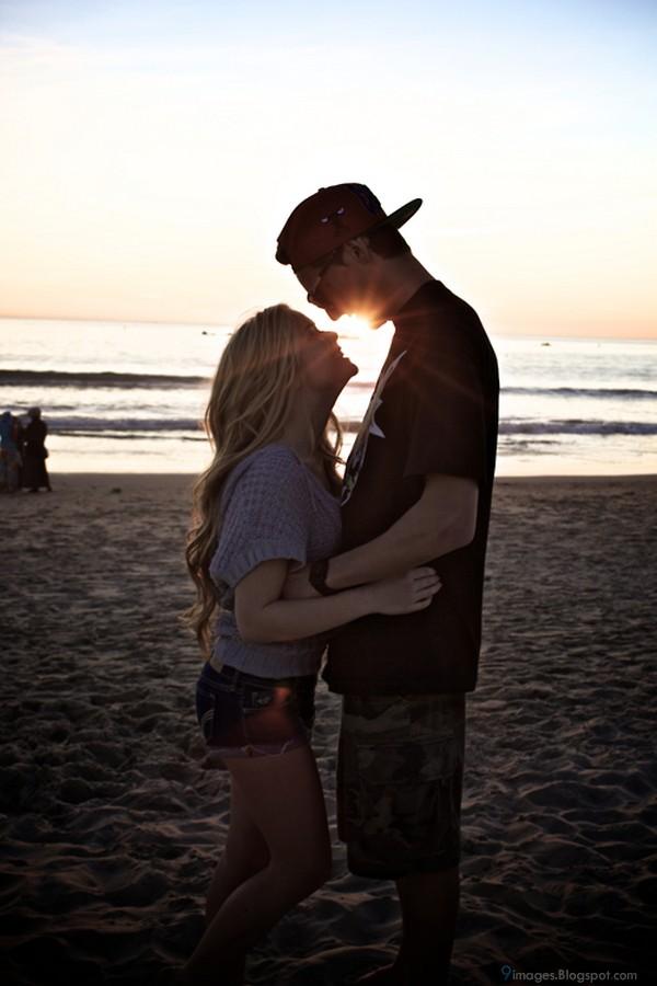 Hug blonde couple beac...