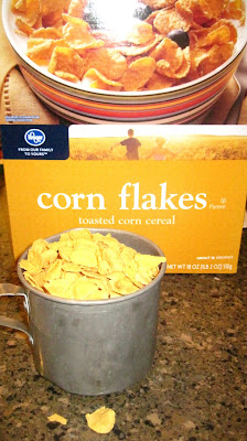 Pour corn Flakes into a large Ziploc bag, squeeze out as much air as ...