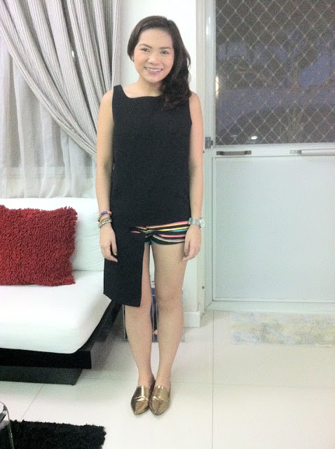 Celine Estella wearing an uneven cut top and tribal shorts from The Urban Hour