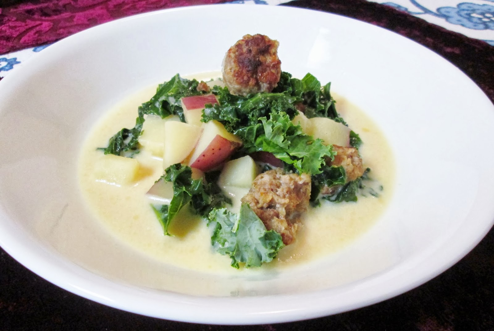 Served in a winter white dish, this soup, with hearty chunks of potato, sausage, and kale, will look scrumptious to all of your family and friends.