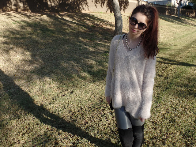 fuzzy pale pink oversize sweater with leggings and over the knee boots
