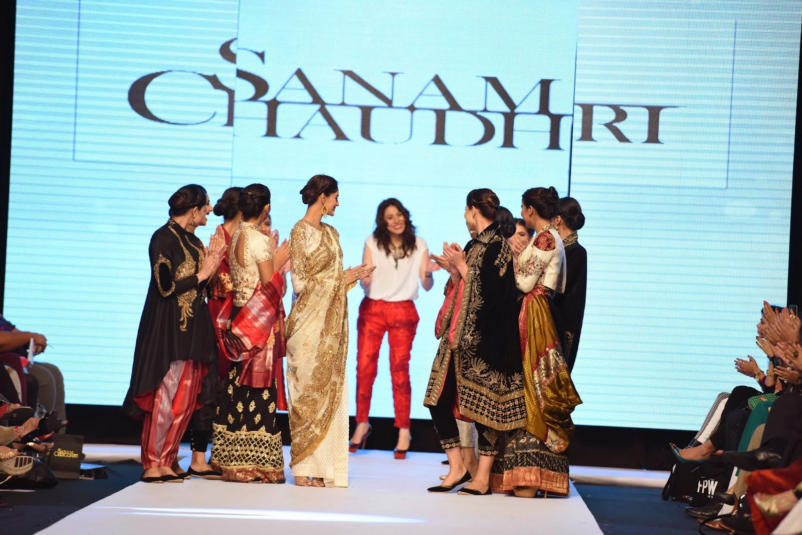 Sanam Chaudhri with the models at the end of the show