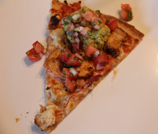 slice of chicken burrito pizza on white plate