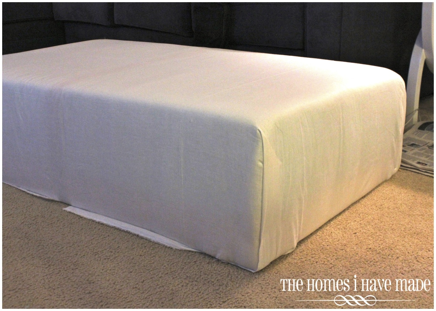 How to make an oversized ottoman tutorial the homes i have made we essentially did the same thing with the white fabric as the batting tug and stapleand at the corners we folded it nicely to avoid bulk solutioingenieria Image collections