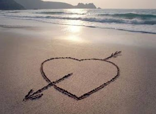Love picture: heart with arrow on the beach