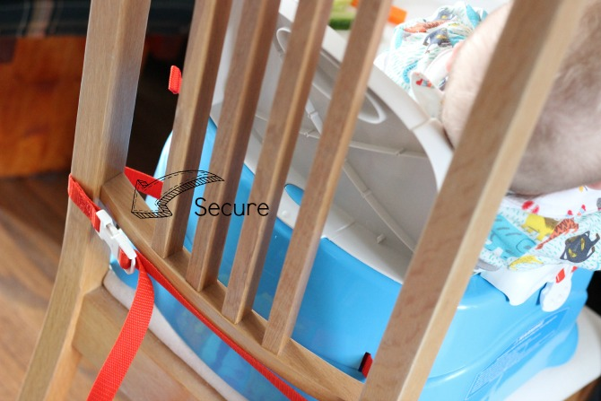 How the high chair fastens onto a dining chair