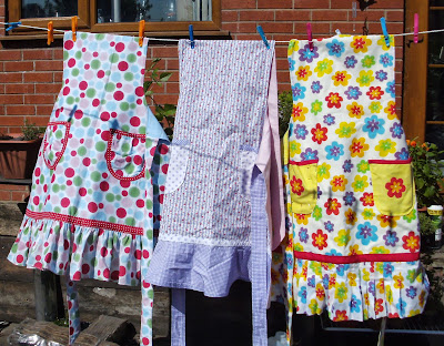 Colourful aprons hanging on washing line