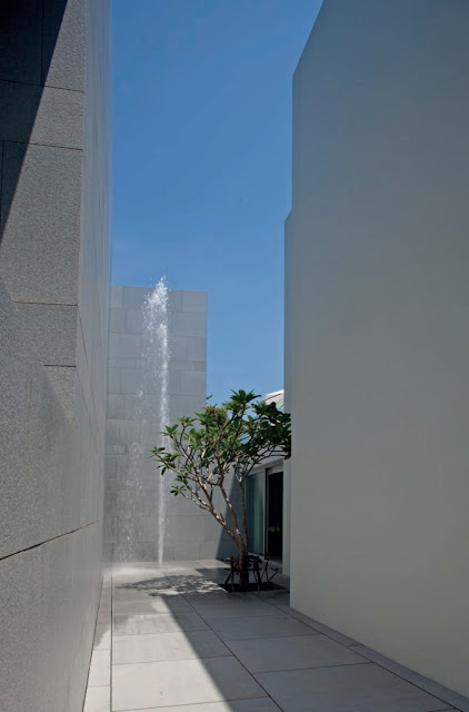 A spectacular two-story-high fountain is located in a deep canyon like courtyard