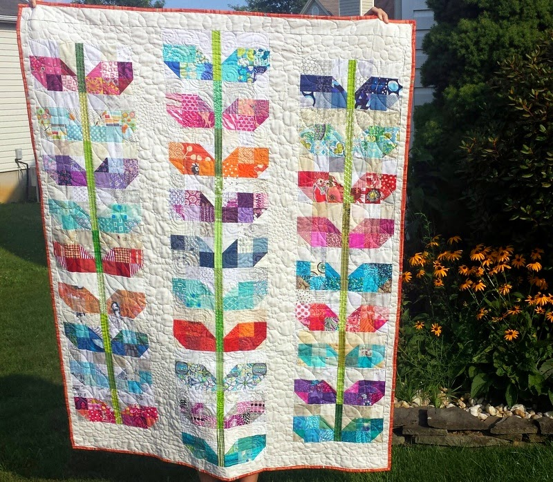http://quiltyhabit.blogspot.com/2014/08/pretty-petals-finished-quilt.html