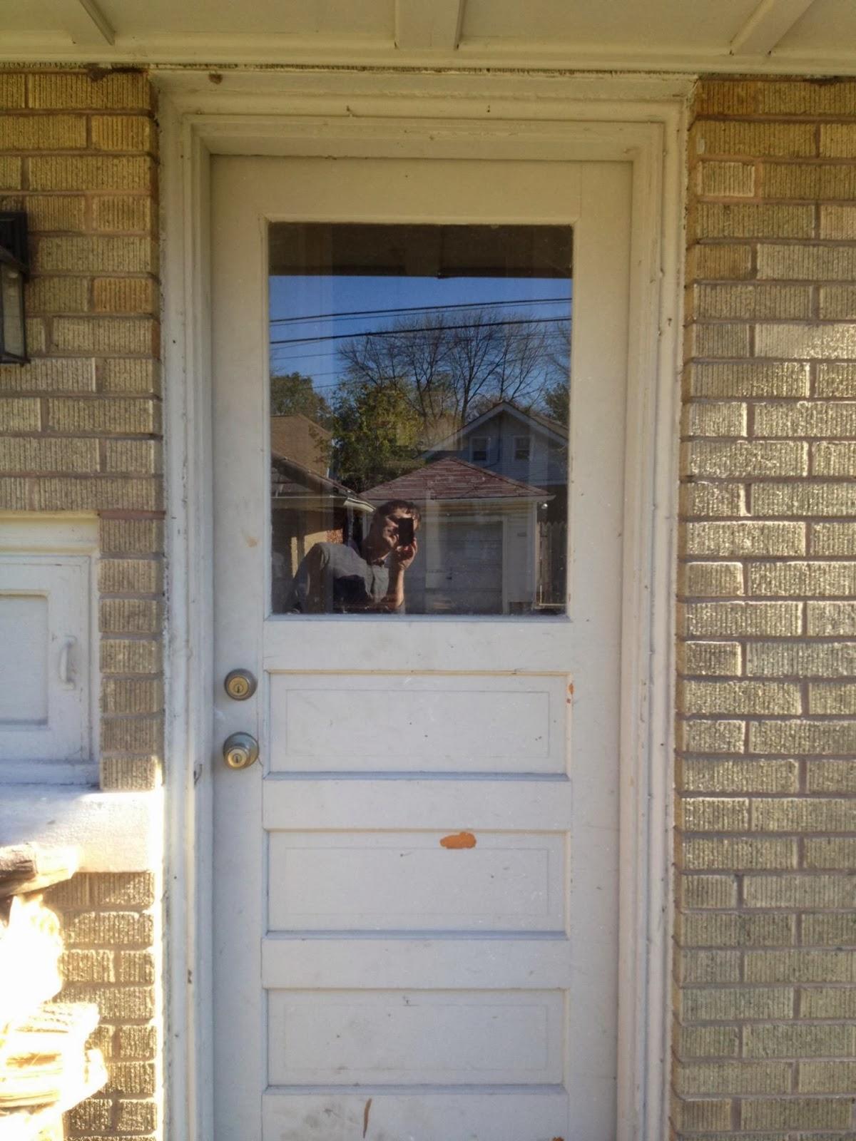 Yellow Brick Home Showing the Back door the door