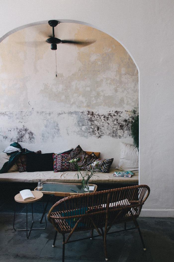Wicker sofa underneath an arch