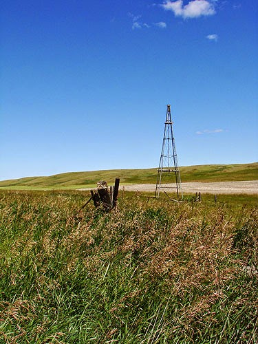 Broken windmill in isolated prairie field - Alberta, Canada.