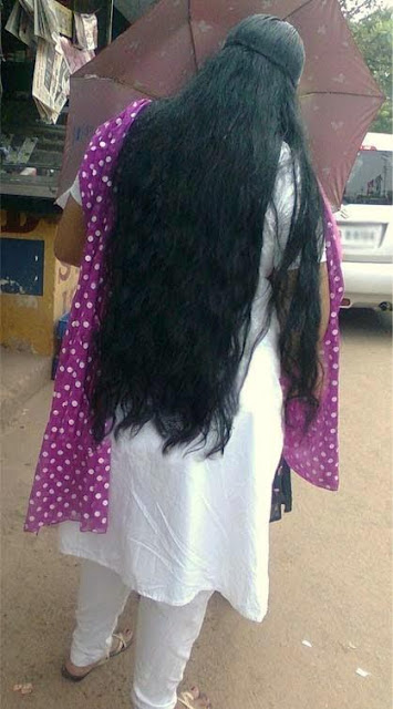 Kerala long hair college girl in loose hair style with her umbrella.