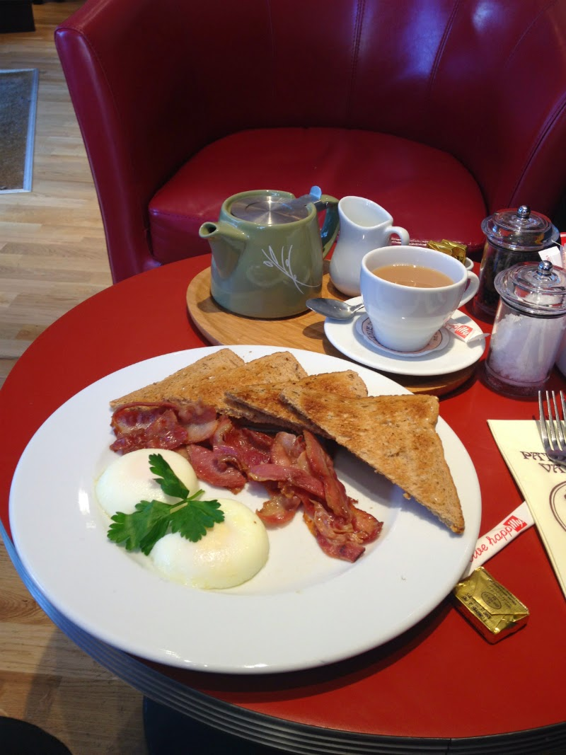 poached eggs and crispy bacon at patisserie valerie south wimbledon london