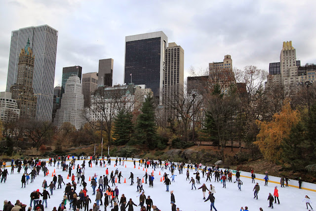 The ice skating ring at Central Park which is located in front of Manhattan skyscrapers in New York, USA